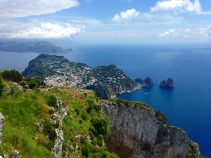 Isle of Capri - A view from the top of M. Solaro over the Faraglioni rocks to the Amalfi Coast beyond.